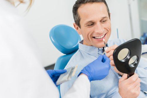 man choosing implant at the dentist